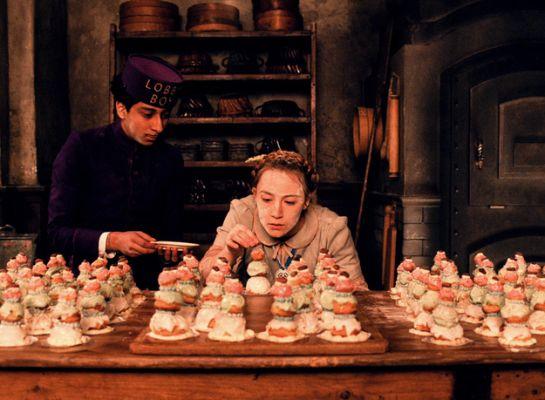 Agatha making Courtesan au Chocolat in the kitchen, Zero beside her.