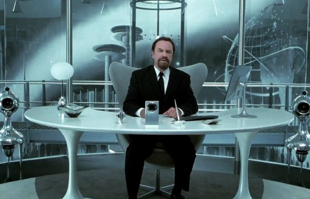 Agent Z sitting on his office chair