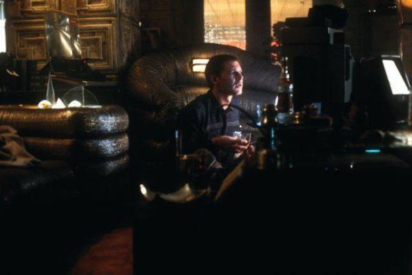 Deckard sitting inside his living area