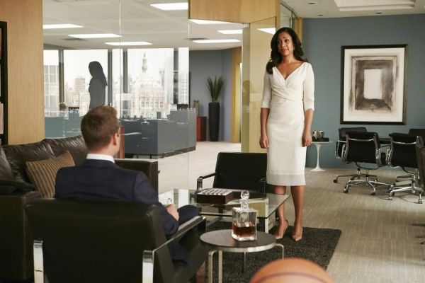 Jessice standing Harvey sitting talking office