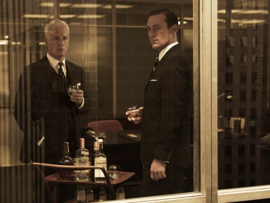 Don Draper and Roger Sterling having a drink together