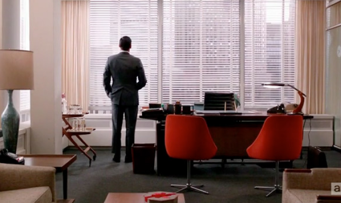 Don Draper staring outside his office window