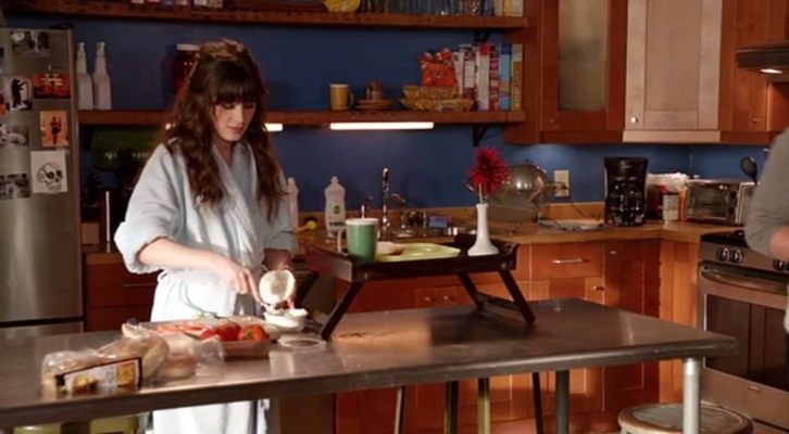 Jess preparing breakfast in the kitchen.