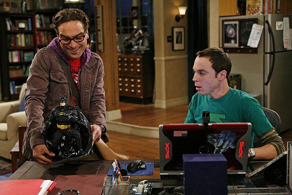 Leonard giving Sheldon a Batman cookie jar.