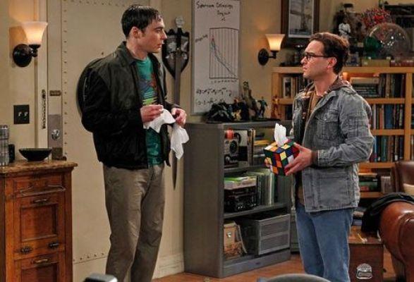 Leonard handing Sheldon tissues.