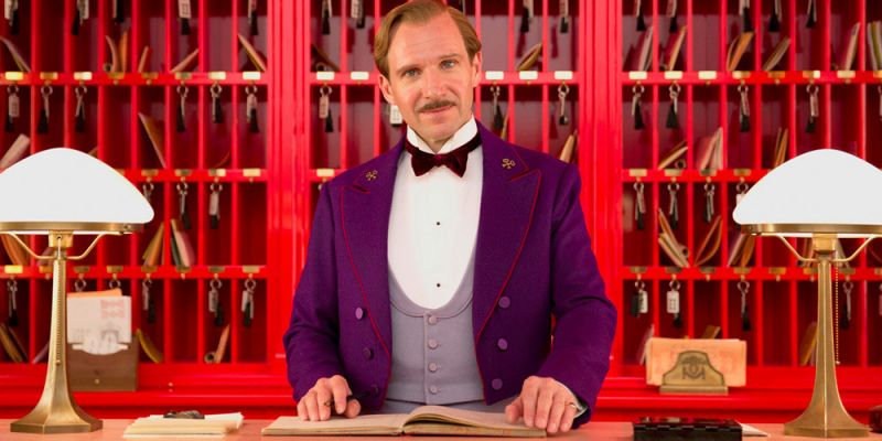 M. Gustave behind the Grand Budapest Hotel's Concierge desk.