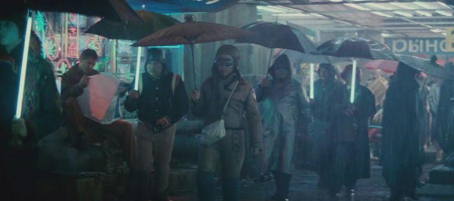 People carrying neon umbrellas