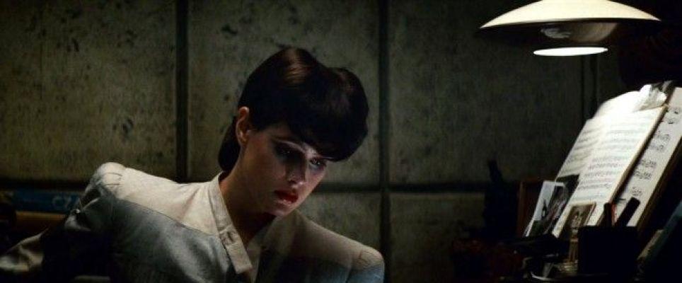 Rachael sitting on her desk
