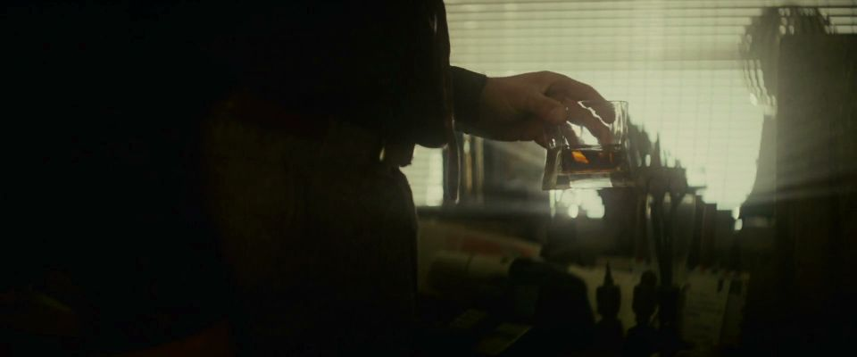 Rick Deckard drinking whiskey in his apartment