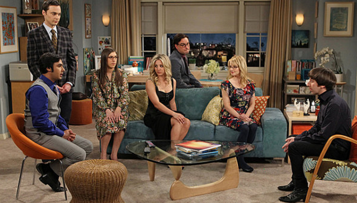 The gang sitting around the Wolowitz's living room.
