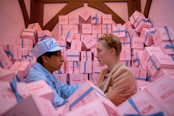 Zero and Agatha amidst boxes of Mendl's Patisserie.